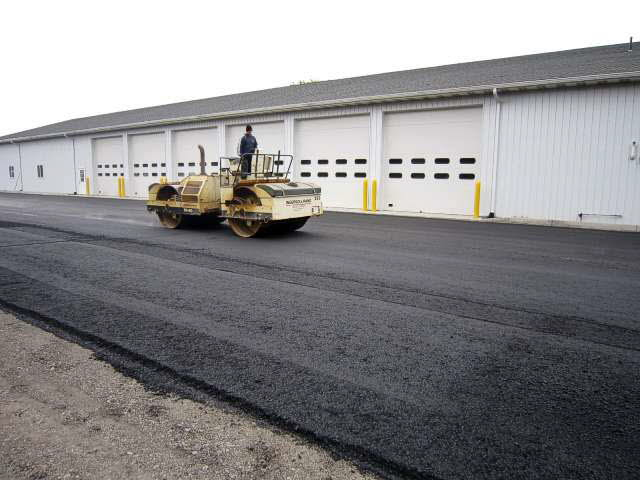 Rolling asphalt with heavy roller.  Photo 13